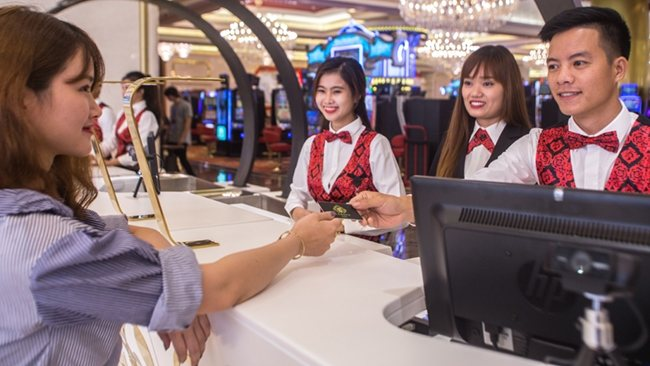 a guest is checking in the receptionist of Corona Casino