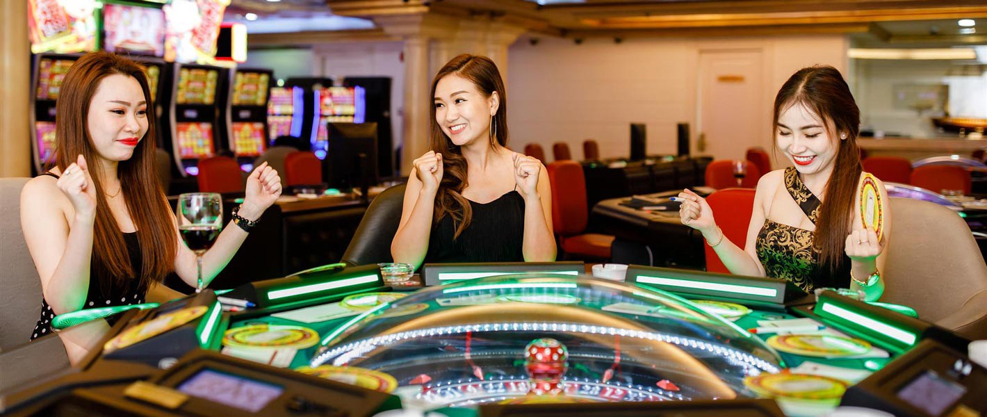 Foreigners playing in casino club in Saigon